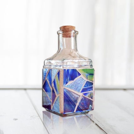 small blue mosaic bottle